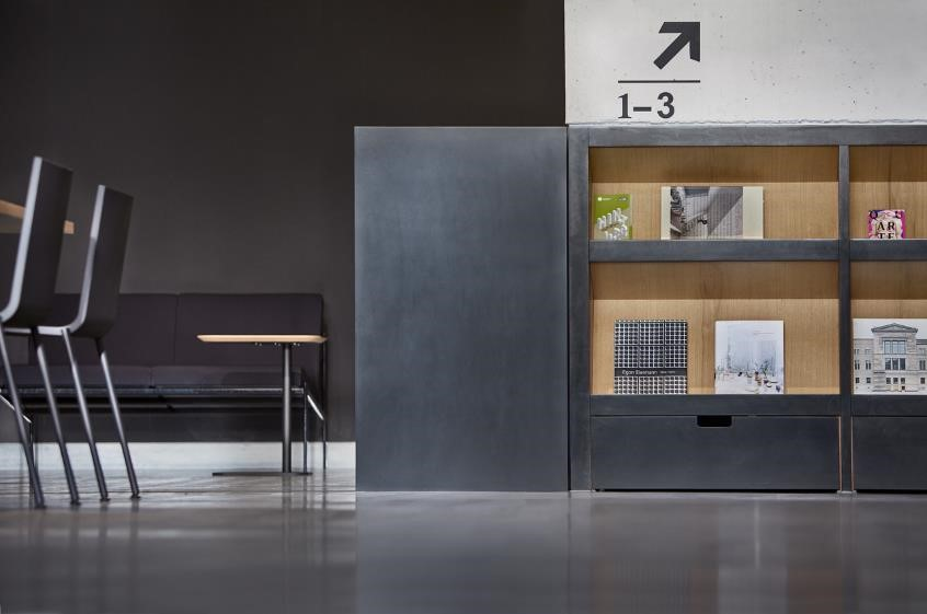 The Reception Desk At Entrance Is In Form Of A Solid Dark Monolith Corian Surface That Reveals Warm Oak Interior Only When Opened Out
